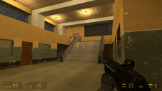 The view from the cover area shows a pair of doors with red lights, implying that they're blocking the player's path.