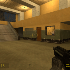 Entering the building, the player sees a large staircase to their left. Some more enemies appear, but a good source of cover is directly across the main area.
